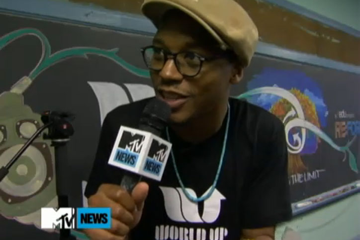 Lupe Fiasco wears the World Up logo I designed on MTV